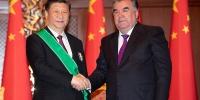 """习近平出席仪式 接受塔吉克斯坦总统拉赫蒙授予""""王冠勋章"""" - 西安网"""